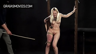 Willing slaves get their bottoms whipped and tits punished