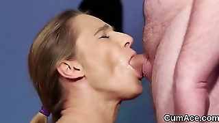 Flirty hottie gets cum shot on her face eating all the juice